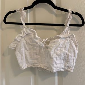 Lioness White top with ruffle and flower detail